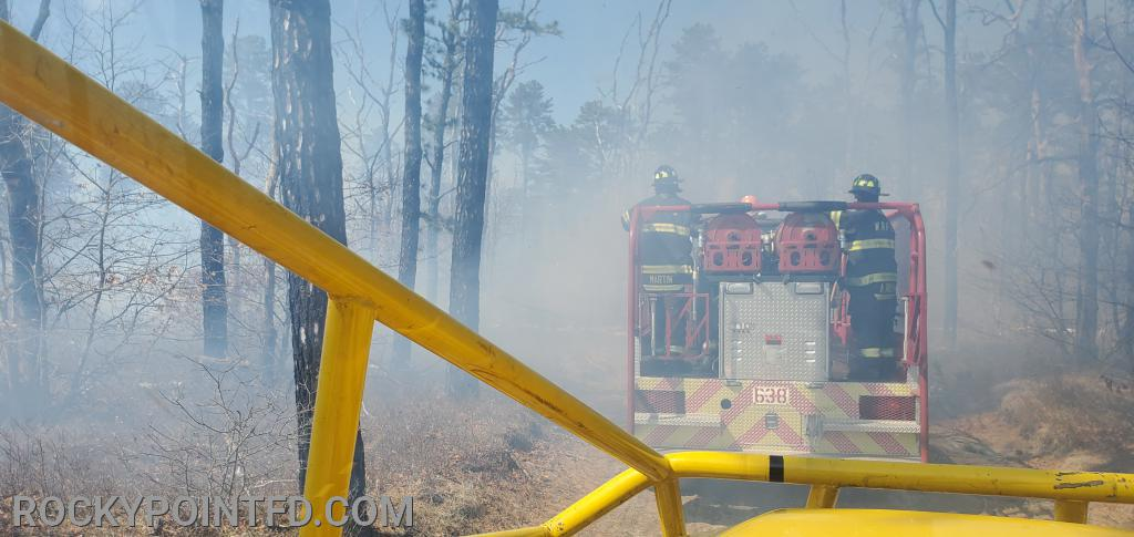 Making our way to the fire on a fire break trail. 5 Brush Trucks